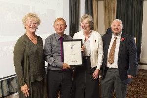 "Receiving the award from 'Remember WW1' in the Army and Navy Club, Pall Mall. Winners of the category Arts and Creativity.  From L-R.  Liz Rawlings, Research and Funding Officer; Dr Peter Grant, Cass Business School (one of the judges); Jane Mills, Chair Llangwm History Society; Sam Howley; composer of the opera ""WW1 - A Village at War""."