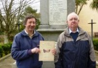 Neil Westerman, Honorary Curator of Tenby Museum holding the Roll of Honour from 1916 with volunteer Kevin Thomas © HLF
